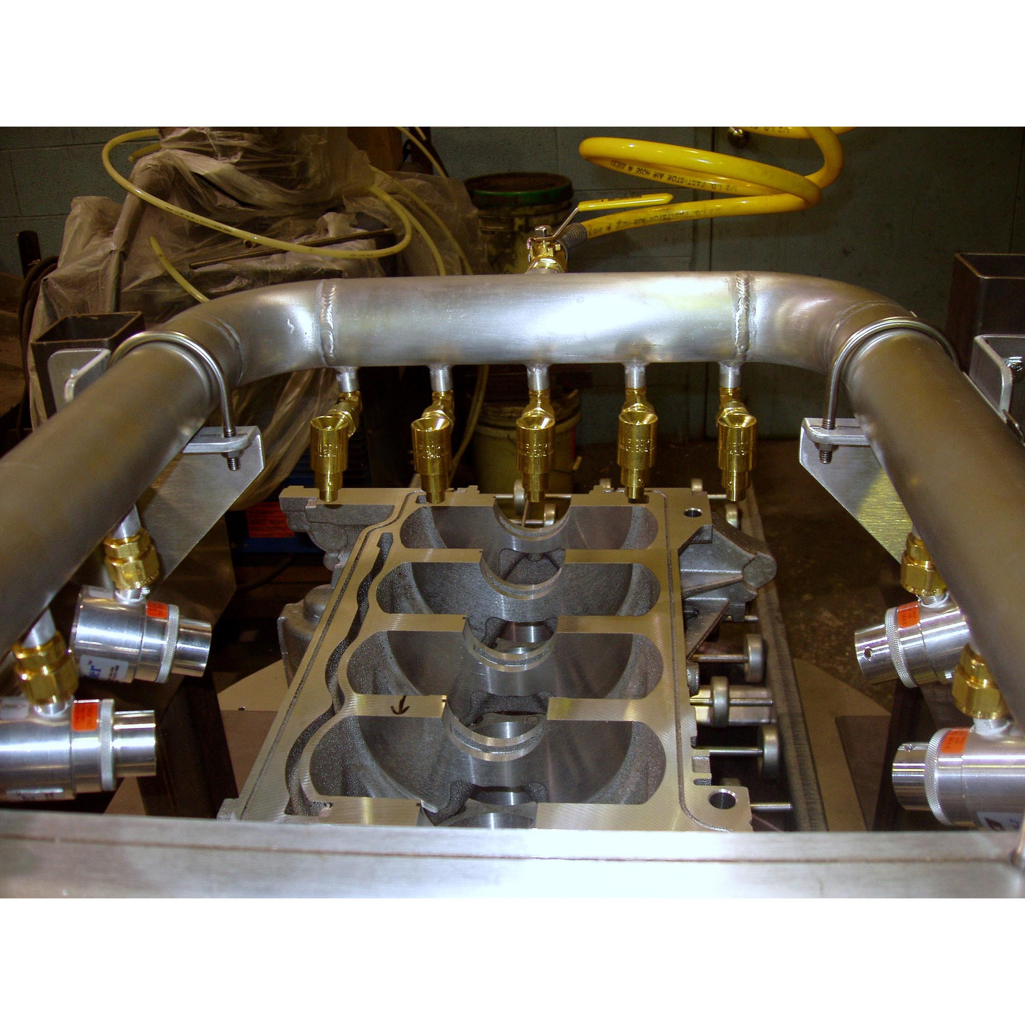 Adjustable Air Amplifiers and High Velocity Air Jets dry an engine block prior to assembly.