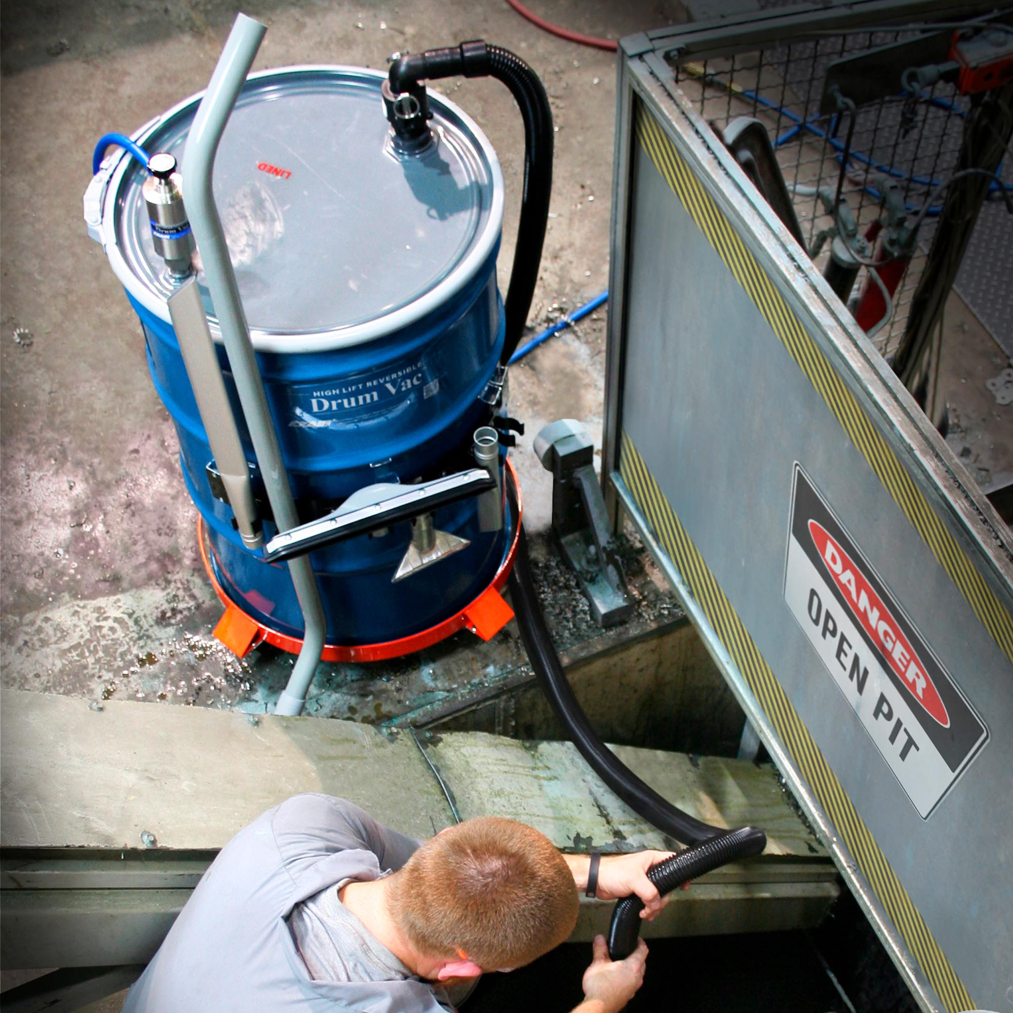 This High Lift Reversible Drum Vac is removing used coolant from a deep pit.