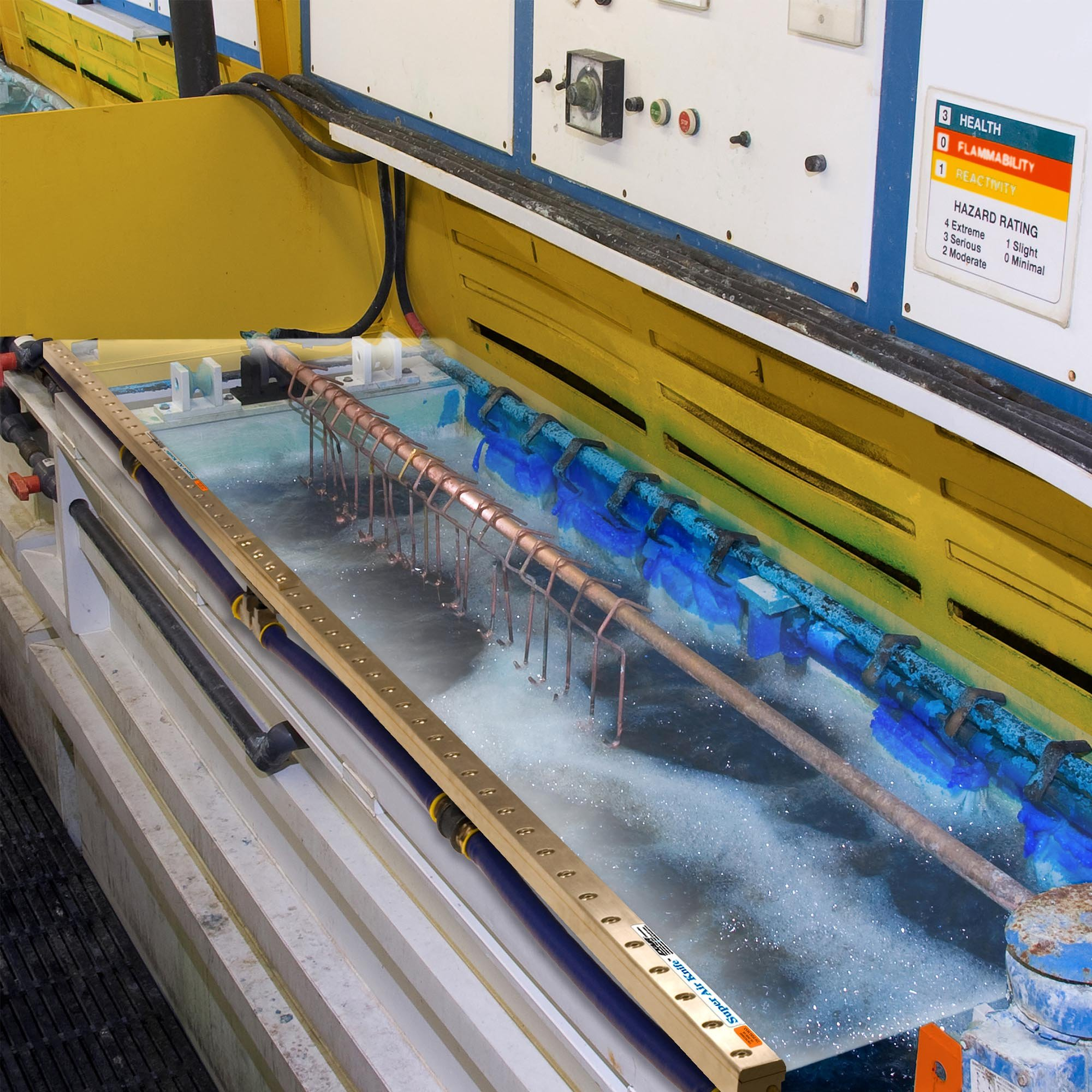 An aluminum Super Air Knife with Plumbing Kit blowing off debris and cooling sheet metal during a laser cutting operation.