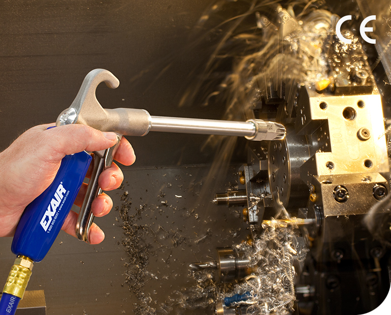 """This Soft Grip Safety Air Gun with 6"""" Extension Pipe makes it easier to blow off shavings and coolant from this drilling fixture."""