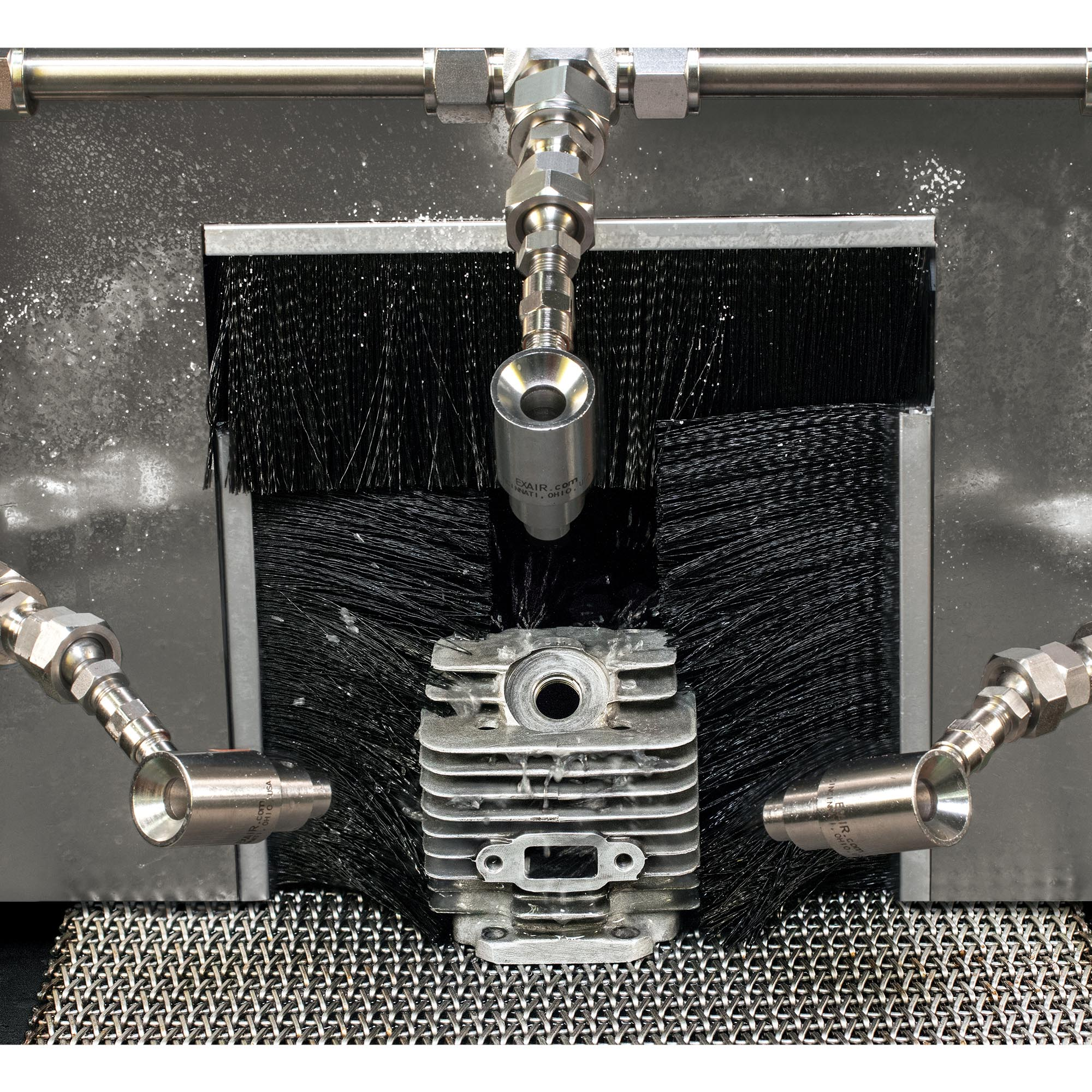 A combination of Model 6013 High Velocity Air Jets dry this chainsaw cylinder head.