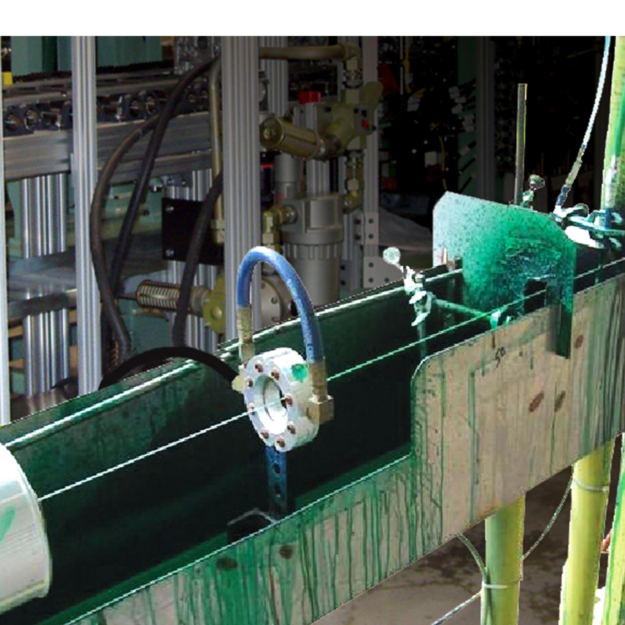 """This 1"""" Standard Air Wipe is blowing off the excess coating from a wire into a dip tank."""