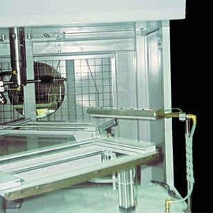A Model 8212 Gen4 Standard Ion Air Knife system cleans metal frames prior to powder coating.