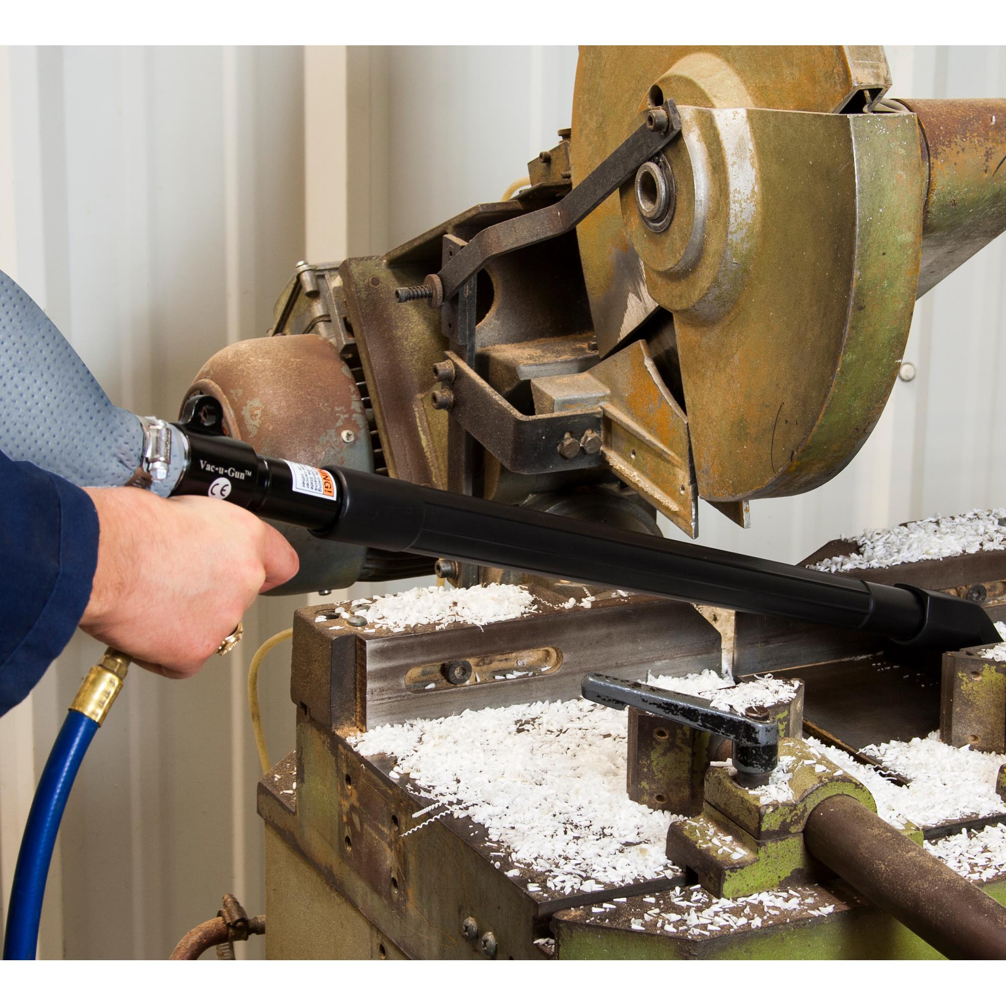A Vac-u-Gun easily removes chips from a saw cutting process.